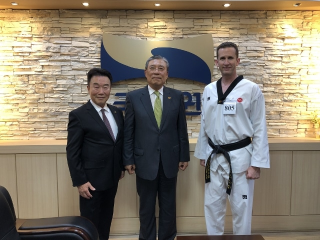Grand Master Cooley pictured with KTA Founder, Grand Master Chul Koo Yoon, and Kukkiwon President, Choi Young Ryul, at the Kukkiwon on the occasion of his 8th Dan Promotion – May 2019
